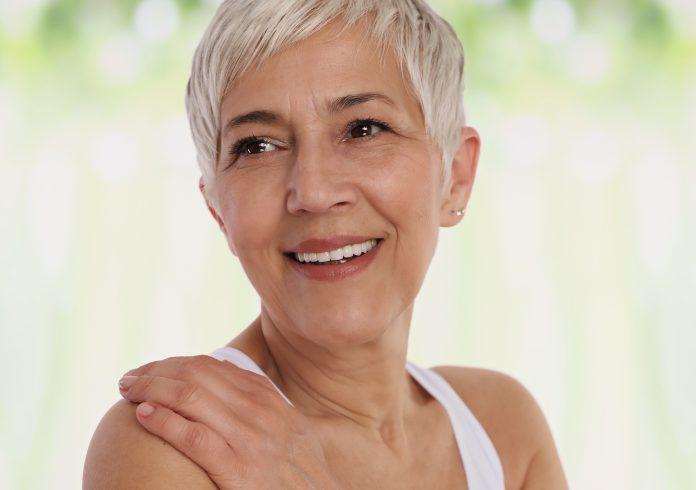 Smiling Mature Woman Portrait. Older skin care, Aging gracefully concept.