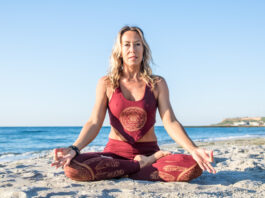 caucasian healthy adult woman with beautiful body doing yoga meditation at sunrise on the beach, yoga poses