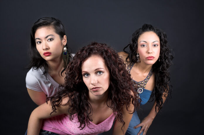 image of three young women