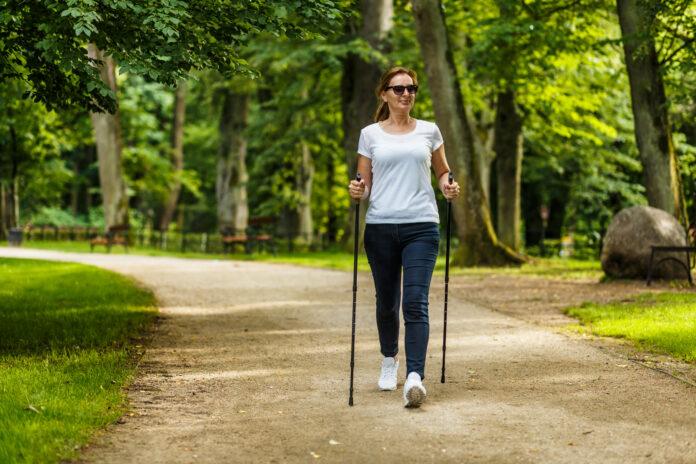 People nordic walking in city park