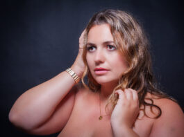 Portrait of a beautiful fat woman with big breasts. blond model overweight.