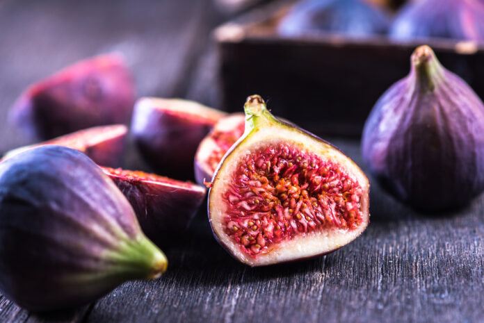 Whole and cut fresh vibrant figs fruit from above