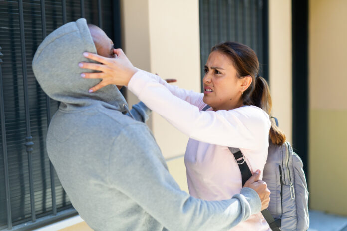 Woman defends herself from attacker rapist on the street