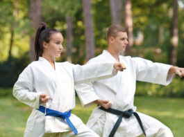 Young couple practicing karate doing Oi-tsuki punch.