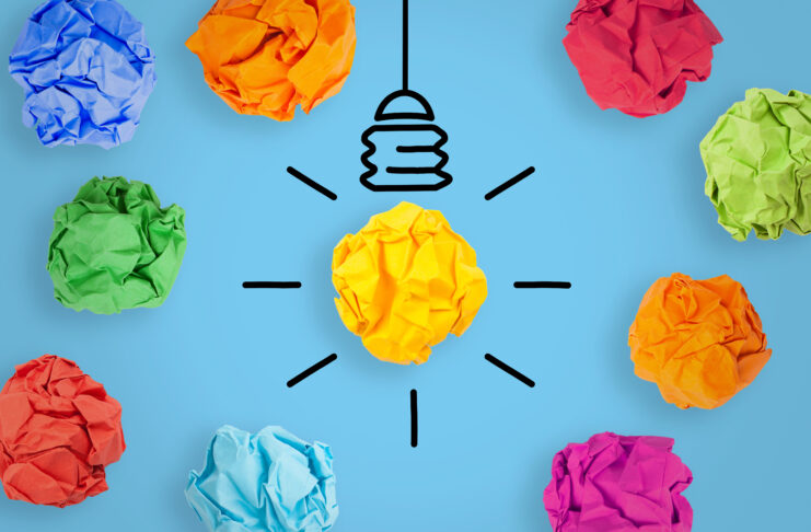 Creative Idea Concepts with Light Bulb Crumpled Paper on Blue Background