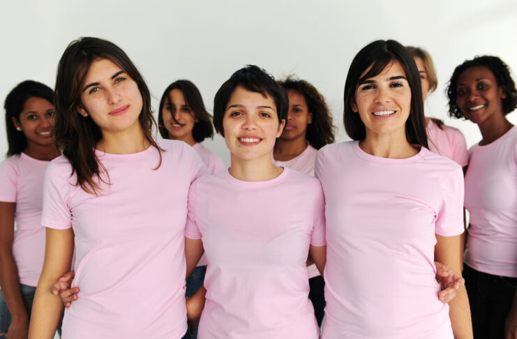 diverse group of women wearing pink for breast cancer awareness