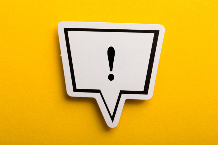 Exclamation Mark speech bubble isolated on yellow background.