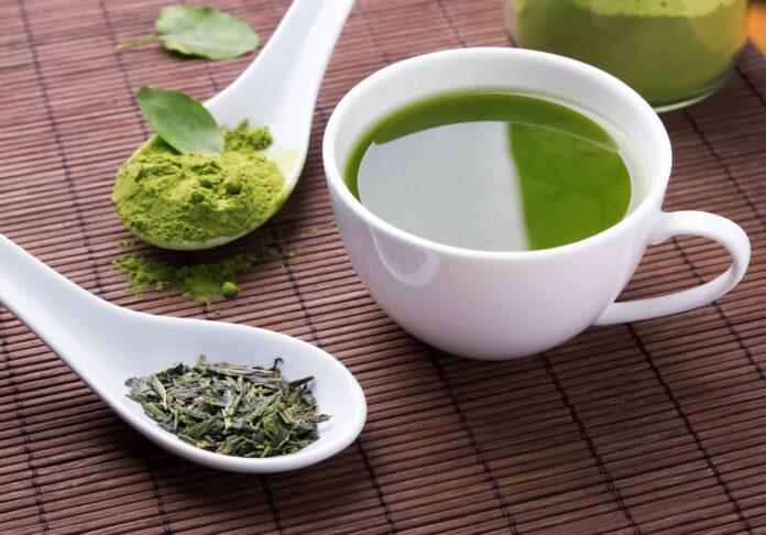 Green tea on the brown mat close-up