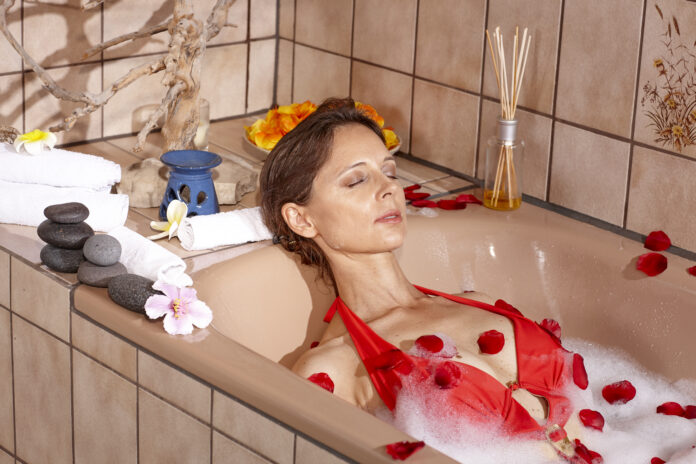 Mature woman with brown hair enjoys her spa treatmants