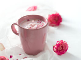 Rose moon milk for a better sleep on a white background. Ayurveda warm drink consumed before bed. Nice in case of sleeplessness, anxiety and insomnia