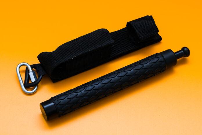 Black telescopic expandable baton / truncheon isolated