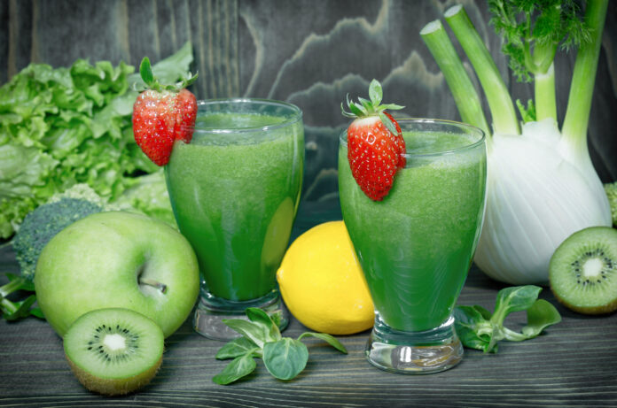 Healthy green smoothie on table, strong antioxidant