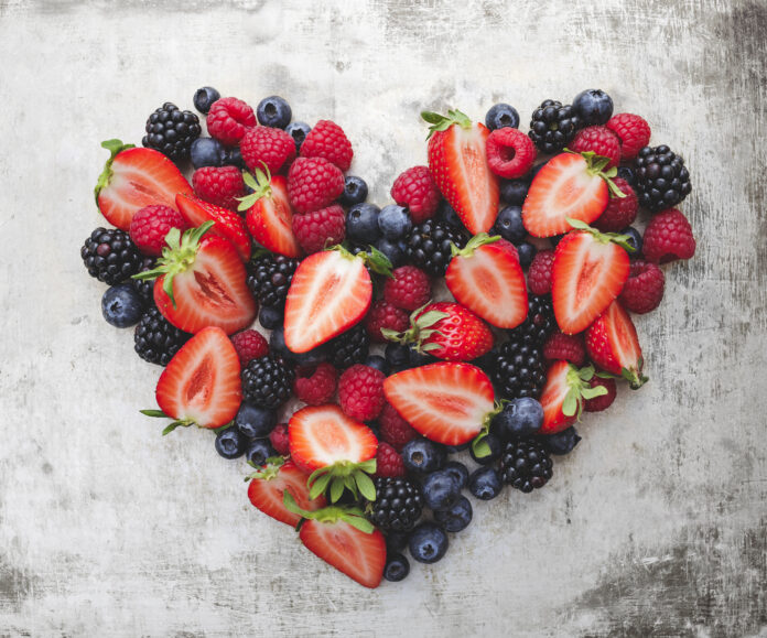 heart, formed from different berries like strawberries, blackberries, raspberries and blueberries