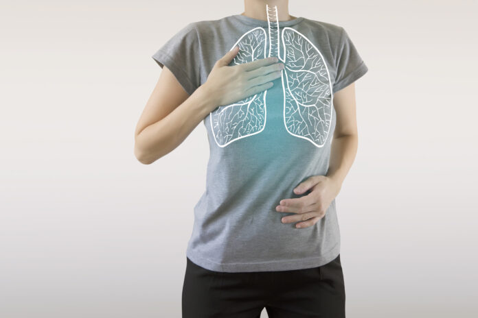 highlighted blue  healthy lungs on woman body
