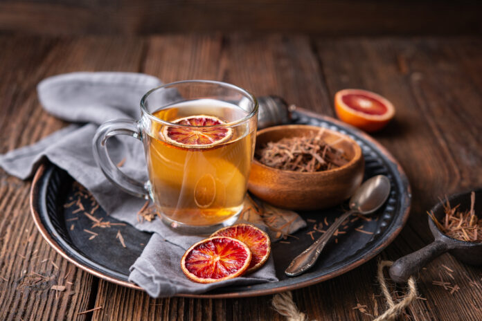 Medicinal Pau d'Arco bark tea also known as Lapacho in a glass cup on wooden background