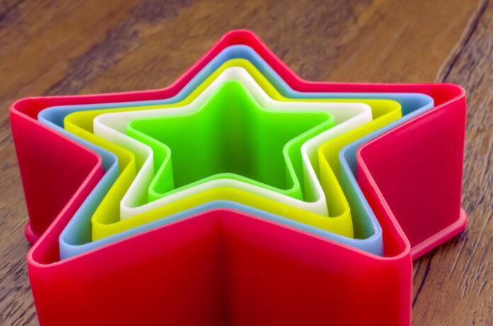 Rainbow Plastic Stars on Wooden Background, Image for Creative idea