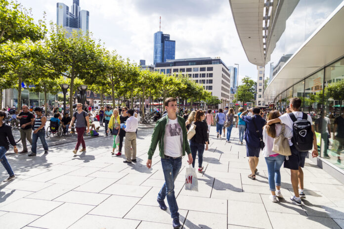 Frankfurt, Germany - August 9, 2014: people walk along the Zeil in Midday  in Frankfurt, Germany. Since the 19th century it is of the most famous and busiest shopping streets in Germany.