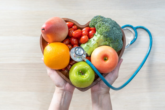 Nutritional food for heart health wellness by cholesterol diet and healthy nutrition eating with clean fruits and vegetables in heart dish by nutritionist and doctor recommended for patient well-being