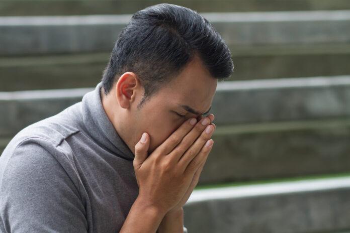 allergic sick asian man sneezing