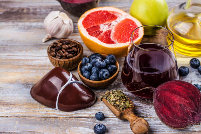 Assortment of foods for healthy liver. Detox nutrition after alcohol and over eating. Copy space