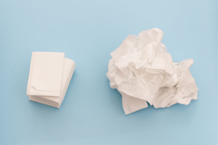 Used and new tissues on blue background. Concept of sick, flu and cold, crying, untidy, masturbation. in Barcelona, CT, Spain