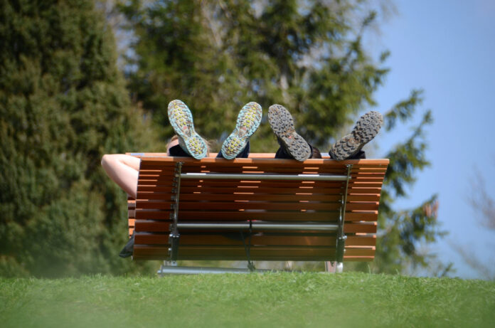 Wipp lounger from the front with resting hikers on the Grünberg near Gmunden, Austria, Europe