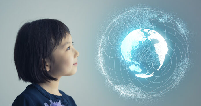 Asian little girl watching a holographic planet earth. Science concept.