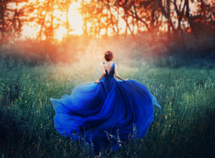 magical picture, girl with red hair runs into dark mysterious forest, lady in long elegant royal expensive emerald green turquoise dress with flying train, amazing transformation during fiery sunset.